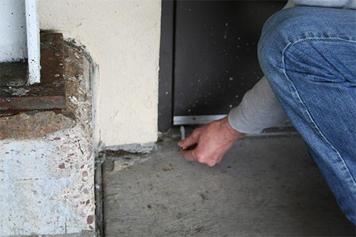 checking a door sweep for gaps
